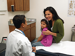 Health Care Professionals - Doctor with Mother and Daughter